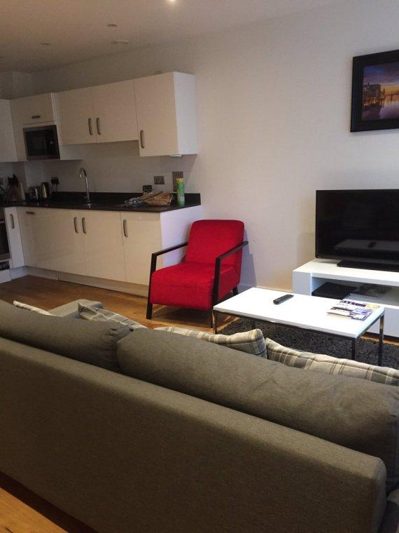 Apple apts livingroom kitchen